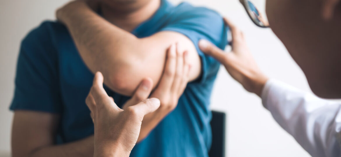 Physical therapists are checking patients elbows at the clinic office room